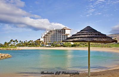Ko' Olina Resort with beachside umbrella in Oahu, Hawaii.