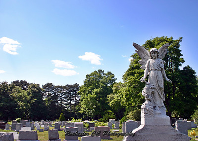 Angel grave marker in Mt. Hope Cemetery.  Cemetery is located in Rochester, NY.