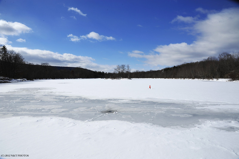 A frozen Lake Francis, notice the fresh opening for ice fishing. I guess the cold weather kept the fishermen away.