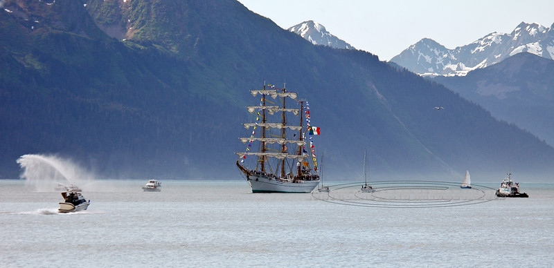A Mexican Tall Ship named the CUAUHTEMOC after an Aztec Chief. 2005.6.4#009.3. The first time a Tall ship had ever entered Resurrection Bay and Seward Harbor. We didn't know it was coming when we decided to camp on the beach for the weekend. It was an amazing show with a lot of Pomp & Circumstance. Viewed in Seward Alaska. See more images of this event in the Western Landscape Gallery, collated by State and date.