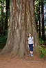 2021.6.20#8700.3. My wife Mary Lou giving perspective to the size of this Coastal Redwood. In the Stout Grove of the Jedediah Smith Redwood State Park, CA.