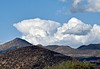 "A ""Classic"" Anvil shaped Cumulonimbus cloud forming over the Bradshaw Mountains. 2021.4.22#6590.2. Viewed from Iron Springs road half way between Skull Valley and Prescott Arizona."