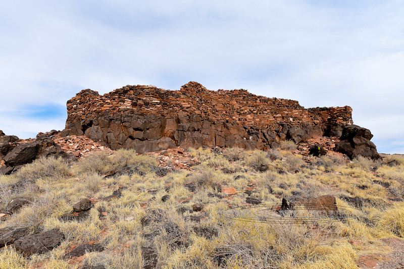 An Anasazi pueblo ruin called the Citadel 2018.6.6#606. Built entirely on an existing basalt outcrop. Wupatki Nat. Monument Arizona.