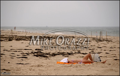 A sunbather on the beach in the Cape Cod National Seashore in Provincetown, Massachusetts.