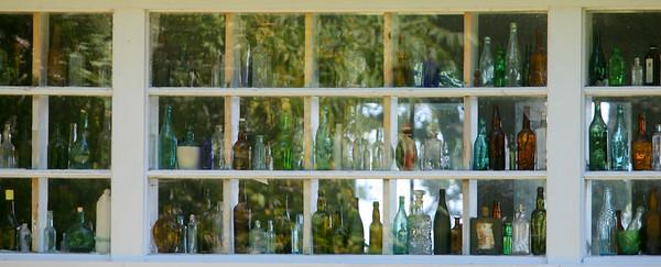 Coloured Bottles in Window,  Long Beach, Washington