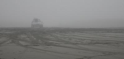 Car in the fog  on Long  Beach Highway, Washington