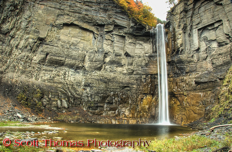 """<a href=""""http://www.priweb.org/ed/finger_lakes/taughannock_falls.html"""" target=""""new"""">Taughannock Falls</a> as seen from the viewing area is 215 feet high which is 33 feet higher than Niagara Falls. It is the highest free-falling waterfall in the northeastern United States, and one of the highest waterfalls of any kind east of the Rocky Mountains. The water hits with such force, the plunge pool at the bottom is 30 feet deep.  The falls is in the Taughannock Falls State Park near Ithaca, New York."""