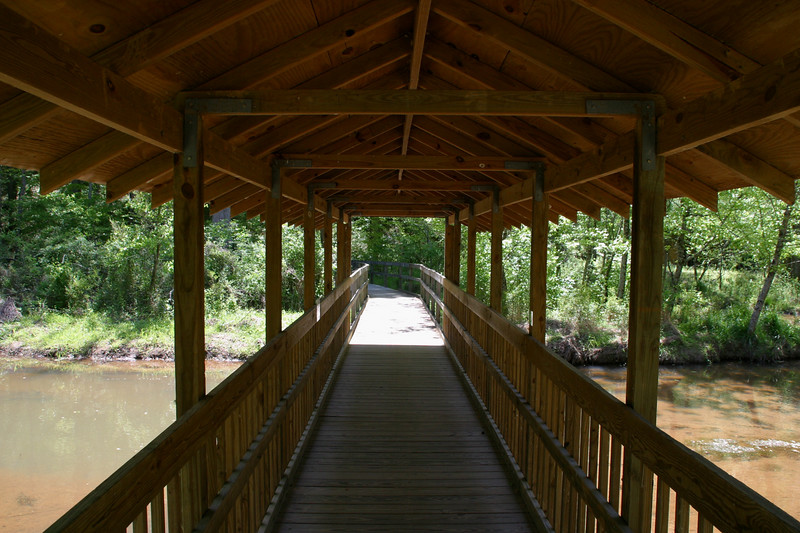 The covered bridge over Pate's Creek, which winds through the wetlands.