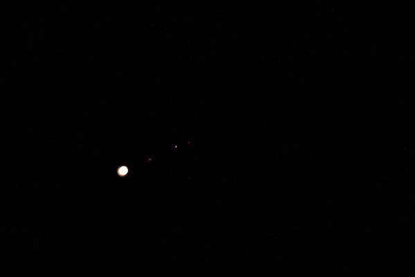Jupiter and three of its moons, from left to right: Europa, Ganymede and Callisto.
