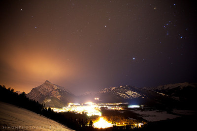 Orions Belt over the town of Banff at night.