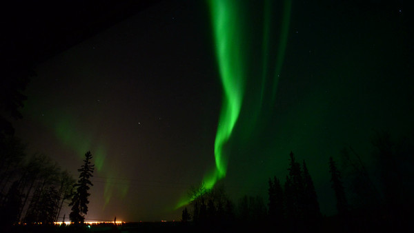 Time lapse of the aurora taken out the window of our house, looking toward Fairbanks, Alaska.  Shots were taken every 15 seconds for 7.5 hours, starting around 11PM local time on March 16, 2013.