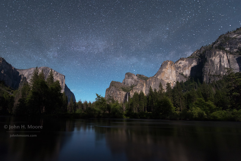 The Milky Way rises over Bridalveil Falls, El Capitan, and the Merced River in Yosemite Valley on a partial moonlit night.  Yosemite National Park, California, USA.  This is an 11-shot composite image for noise reduction.