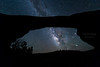 An Aquariid meteor explodes below Mars after streaking across the Milky Way on a clear, dark night in Utah.