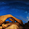 "The Milky Way mimics a rock arch in the predawn ""blue hour"""