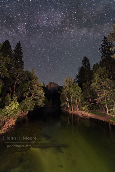 Half Dome as seen from Sentinel Bridge in Yosemite National Park at night with the Milky Way above.  Califronia, USA