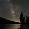 The Milky Way over Tenaya Lake in the high country of Yosemite National Park.  California, USA.