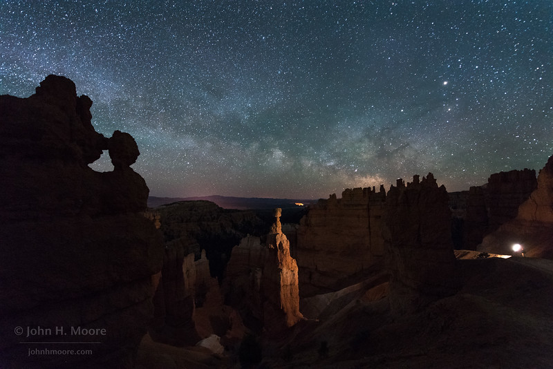 Self-portrait of the photographer light-painting Thor's Hammer in Bryce Canyon National Park.  Utah, USA.