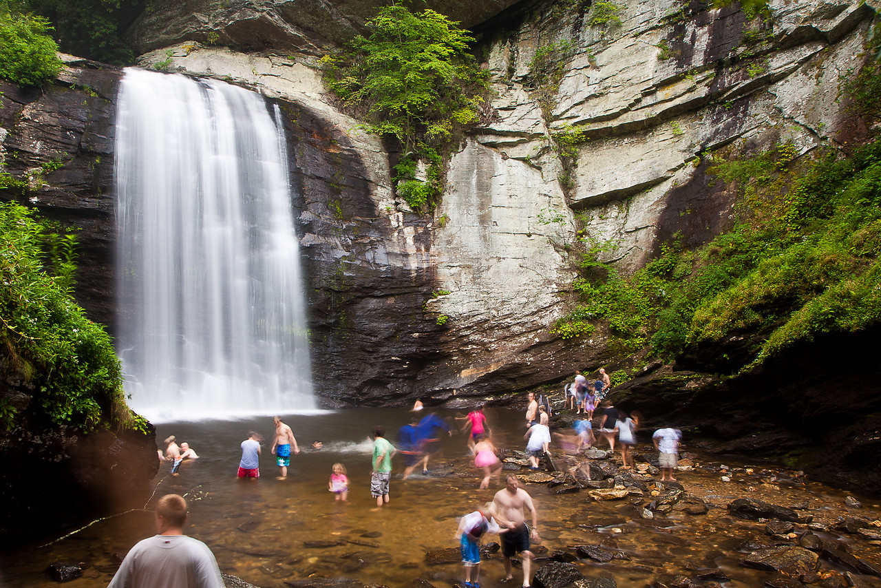 People playing below Looking Glass Falls in the Pisgah National Forest.