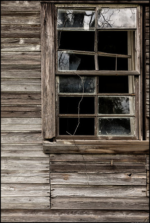 Broken windows in time.  Getting to see walk around and take some pictures of old and relatively deserted homes and barns is always fun.
