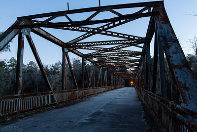 The closed steel bridge across the Suwanee River, formerly part of US Highway 90, taken about 30 minutes after sunset.