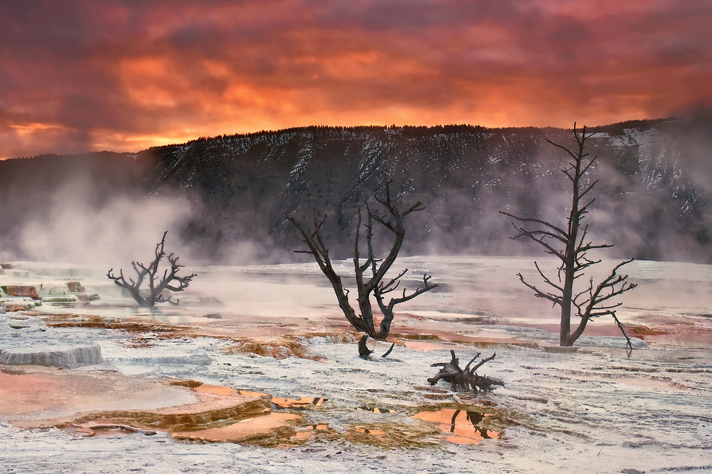 Aftermath<br /> The fiery sunrise compliments the thermal activity below, enhancing the apocalyptic feel to the upper terrace at Mammoth Hot Springs, Yellowstone National Park