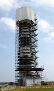 Bodie Island Lighthouse under repair.