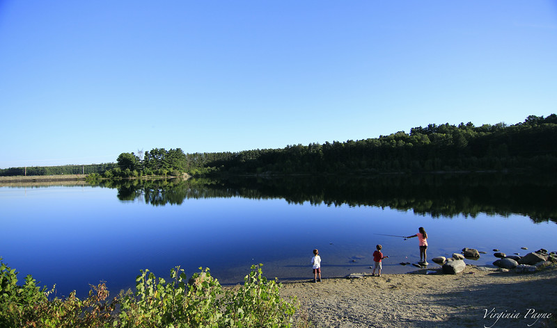 """The kids fishing on the """"lake"""" (reservoir) behind the church"""