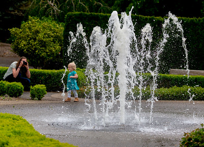 Little girl in the Rose Petal Garden, by the frozen-in-time fountain