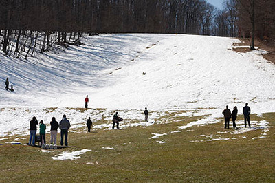 Sledders enjoy the remains of Smowmaggedon 2010