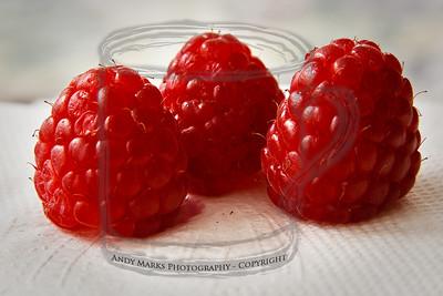 Raspberries on McDonald's napkin - 12mm extension tube test. 31Mar10