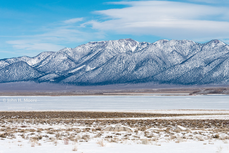 Frozen Lake Crowley with the White Mountains behind