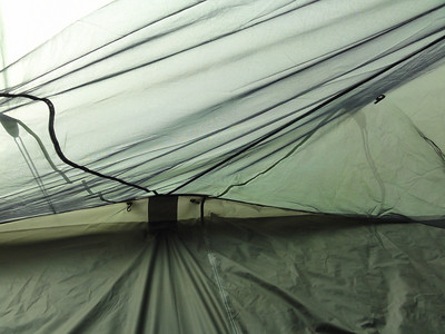 special light weight carabiner clips hold the interior bug netting to the outer rain fly. This allows the tent to have more room on the inside. It prevents the sagging look.