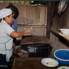 """The cook is roasting up some coffee beans, picked at this location. They are then ground in an old fashion meat grinder. The """"Finca"""" produces organic, shade grown coffee. - Finca Esperanza Verde"""