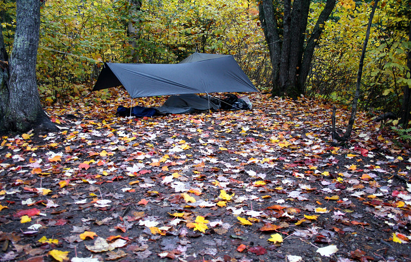 Lightweight backpacking along the Lake Superior Hiking Trail at Lake Egge. An Oware cat tarp and a bivy sack makes a great solo shelter.