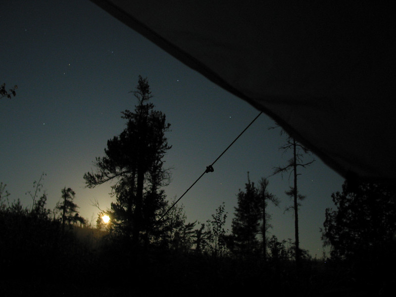 A full moon rising above the horizon woke me. I took this from inside my sleeping bag and tarptent with an 8 second shutter, while propping the camera on an overturned boot. First night of solo hike on the Kekekabic trail in the BWCA, May 2005.