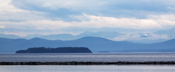 Adirondacks across Lake Champlain from VT on a drizzly spring day