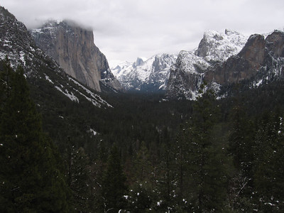 El Capitan in the mist, then Cloud's Rest, Halfdome, the brothers, and Sentinel rock in the snow. Snow doesn't stick to the sheer face of El Cap.