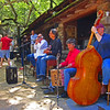 A very pleasant place in the mountains north of Santa Barbara.  some very talented musicians and beef brisket sandwiches make this a must stop on a Sunday Drive. The guy in the red shirt is play a box,