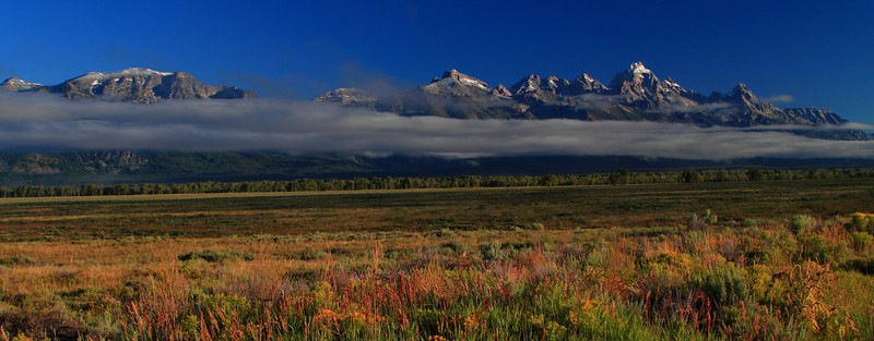 Teton Fog Pano, Grand Teton NP, WY<br /> <br /> Early morning is the best time to shoot the Tetons.  Too bad I didn't get up early enough to spend more time shooting around this area.  I was too tired from the sunrise to sunset excursions on the previous day (starting in Yellowstone, ending in Jackson Hole).