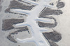 An aerial photo of a frozen lake.