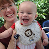 Smiling baby with lion on bib