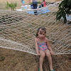 Left out - little girl pouting on hammock while others play in the kiddie pool
