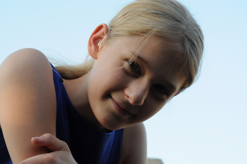 attentive friend - young girl - smiling girl with hearing aid<br /> @2009_CEQ