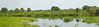 This is panorama from the front of the tower off of Road 16  looking west to the Jackson Kissimmee Canal.  I used 9 photos to make this pano using my 70-200mm lens hand holding it vertically.