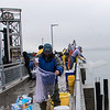 Cast netting Herring from the Ferry Point pier