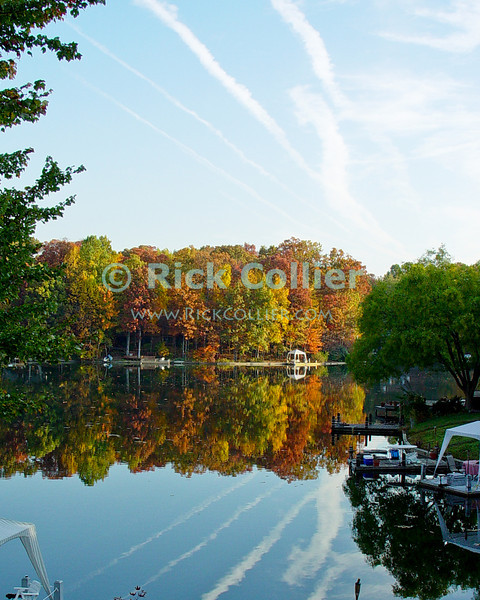 "Lake Thoreau, Reston, Virgina, USA.  © Rick Collier<br /> <br /> <br /> <br /> Lake Thoreau Reston Virgina fall color lake reflection serene serenity reflections tree trees leaves autumn contrails ""jet trails"""