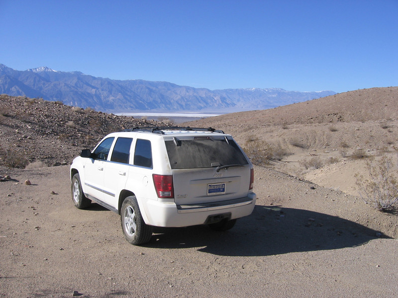 Sam's new Grand Cherokee at base of mountains along eastern edge of Saline Valley in western Death Valley National Park. Time stamps in all photos are one hour too far ahead (forgot to reset camera time from pesky Daylight Savings Time.) Saline Valley playa and Inyo Mountains in distance.  See my personal web page at:  http://bryanlallen.googlepages.com