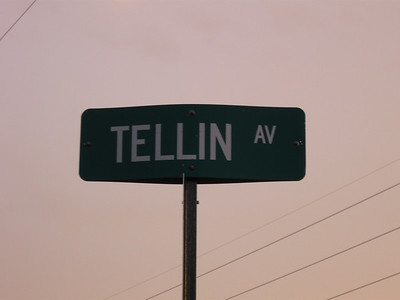 """I'm """"tellin"""" you that I LOVE rainbows and sunsets! LOL! I had to take a photo of this sign."""