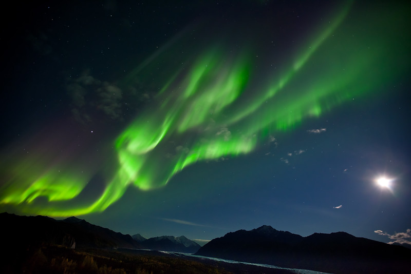 Aurora borealis and a full moon over Matanuska Glacier and the Chugach Mountains, Alaska