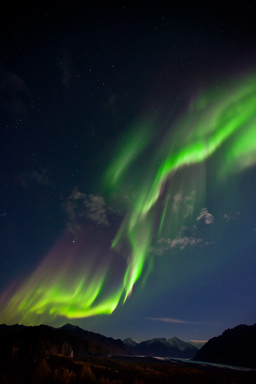 Dancing Lights.  Aurora borealis over the Matanuska Glacier and Chugach mountains, Alaska